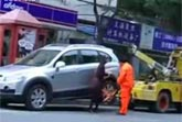 SUV Owns Tow Truck